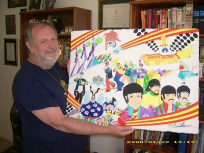 A picture of Ron Campbell, Australian director and animator, with the Beatles cartoon drawing.
