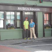 Sally Gibbons Livingston with her son, Bryce in front of the Bunowen Inn, now call Ah Bhun Abhain, formerly the Gibbons pub and butcher shop, birthplace of William Gibbons, Sally's grandfather.