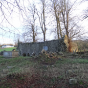 Old graves line the wall at Templeroan graveyard outside Shanballymore, Co. Cork
