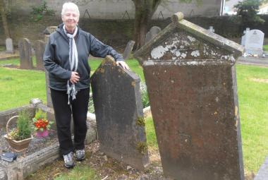 Mary Leonard with headstones in Roscrea Ireland